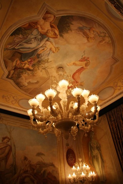 "Image of ""Venetian Villas"" room, decorated with frescos by Mariani Affreschi, dropped ceiling by Bakokko Group and chandelier by I Dogi"