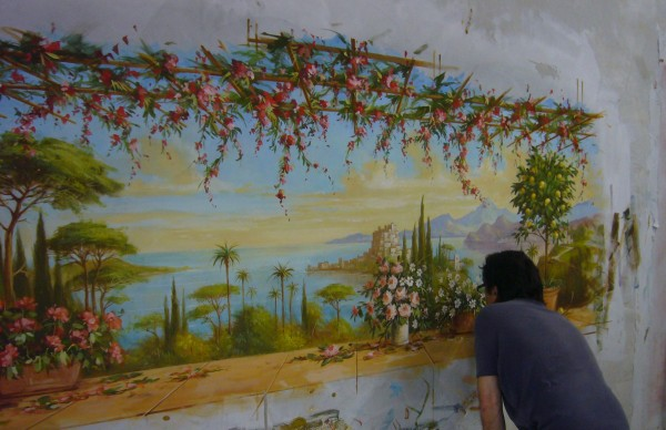 L'esecuzione dell'affresco su intonaco fresco realizzato da un artista di Mariani Affreschi