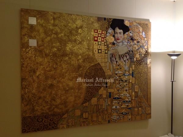 La splendida rivisitazione di un'opera del Klimt, reinterpretata da un'artista di Mariani con tecnica mista su tela. La preziosa lavorazione della foglia oro rende unico questo dipinto.