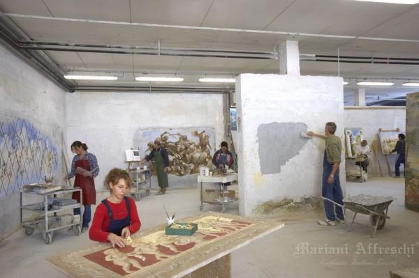 Artisti al lavoro per la realizzazione dell'affresco autentico