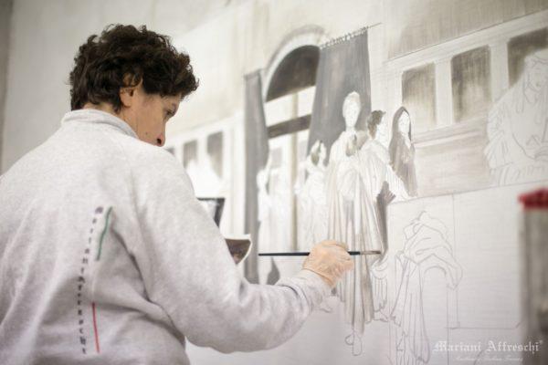L'artista di Mariani stende il colore sull'intonaco ancora fresco, secondo la tecnica autentica