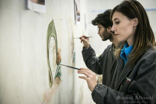 Students of the Mariani Affreschi Academy add the finishing touches to a fresco painting