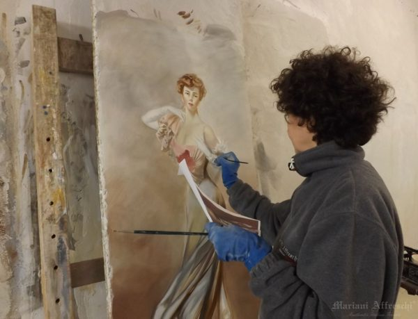 Our Master of Art working on a frescoed portrait of a Lady inspired by Giovanni Boldini