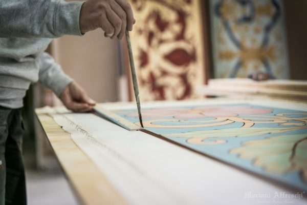 Some finishing touches are made on the fresco before it is shipped to the customer