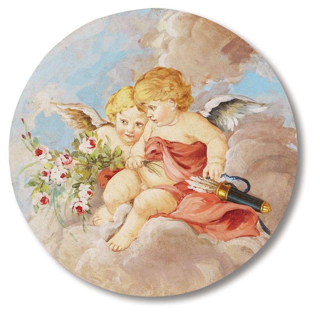Amorini affrescati in un rosone a soffitto.