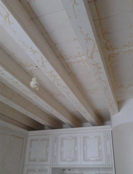 Decorative painting of the wooden ceiling