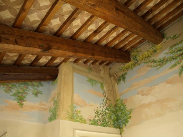 Wall fresco with floral theme for the master bedroom