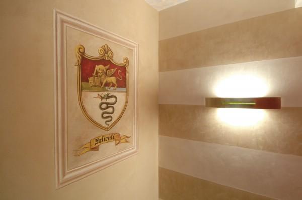 Il logo dell'azienda Salionti elaborato dall'artista di Mariani e realizzato ad affresco