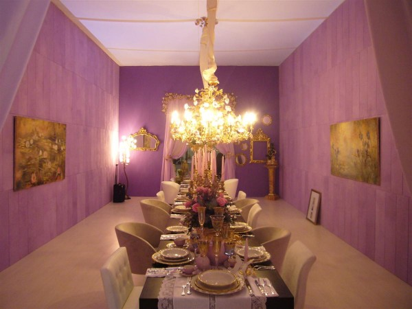 La sala da pranzo della Casa Giardino al Macef con gli affreschi firmati Mariani