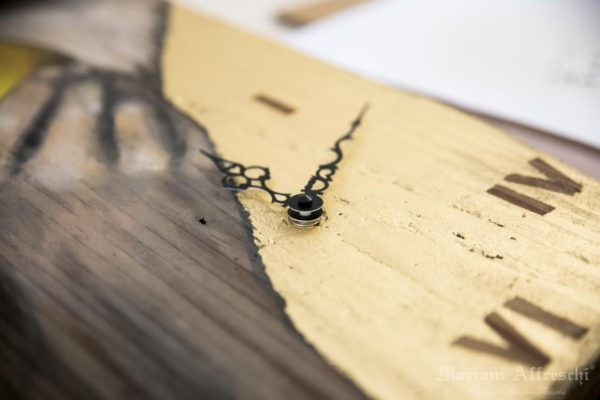 A detail of a Mariani Clock that shows the care and dedication that goes into creating each work of the new collection