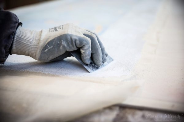 "After the fresco has been removed from the wall, any remaining plaster is removed from the ""negative"" side of the fresco"